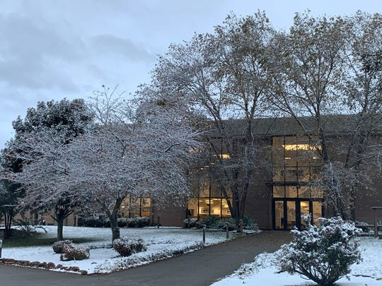 Snow blankets the ground at Farragut High School on Tuesday, Nov. 12, 2019.