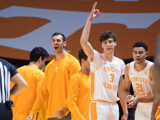 Tennessee forward Uros Plavsic, left, celebrates with teammates during an exhibition game between University of Tennessee and Eastern New Mexico Wednesday, Oct. 30, 2019.