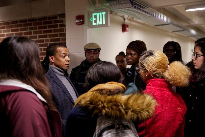 John Gates, Purdue's vice provost for diversity and inclusion, talks with a group of students after a town hall meeting on diversity at Purdue, Monday, Nov. 11, 2019, in West Lafayette.