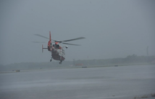 J.R. Carrillo and his Coast Guard crew take off in an Aug. 26, 2017, storm after dropping a load of survivors rescued in southeast Texas during Hurricane Harvey.