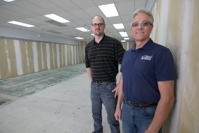 Jon Gebarowski, left, and his father, John Gebarowski, look forward to running Oceanside Seafood in the former RadioShack storefront in Genoa Township, shown Tuesday, Nov. 12, 2019. The elder Gebarowski owns the business, while his son will manage the market.