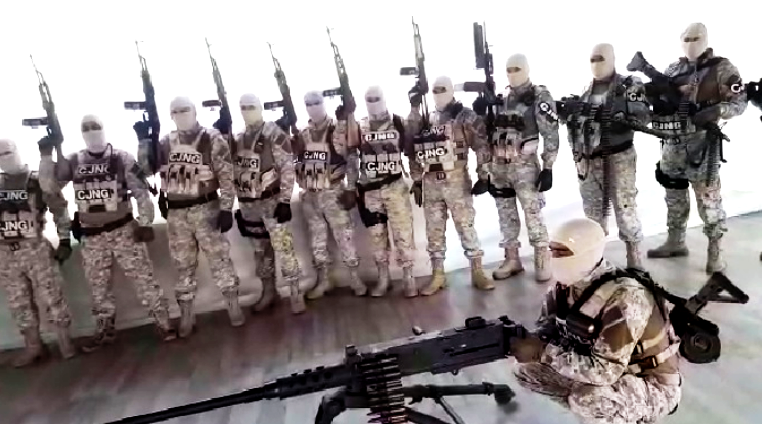 In social media posts, CJNG shows off its military-grade fire power, some of which is illegally bought in the U.S.