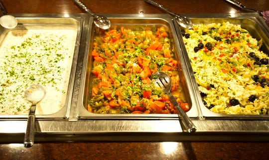 The Al Hamra Restaurant, at Mid-City Mall on Bardstown Road in Louisville, features a buffet of over 45 Middle-Eastern dishes. At left is the tahini salad, center, the tomato-jalepeno salad and at right, pasta salad with vegetables.06 November 2019