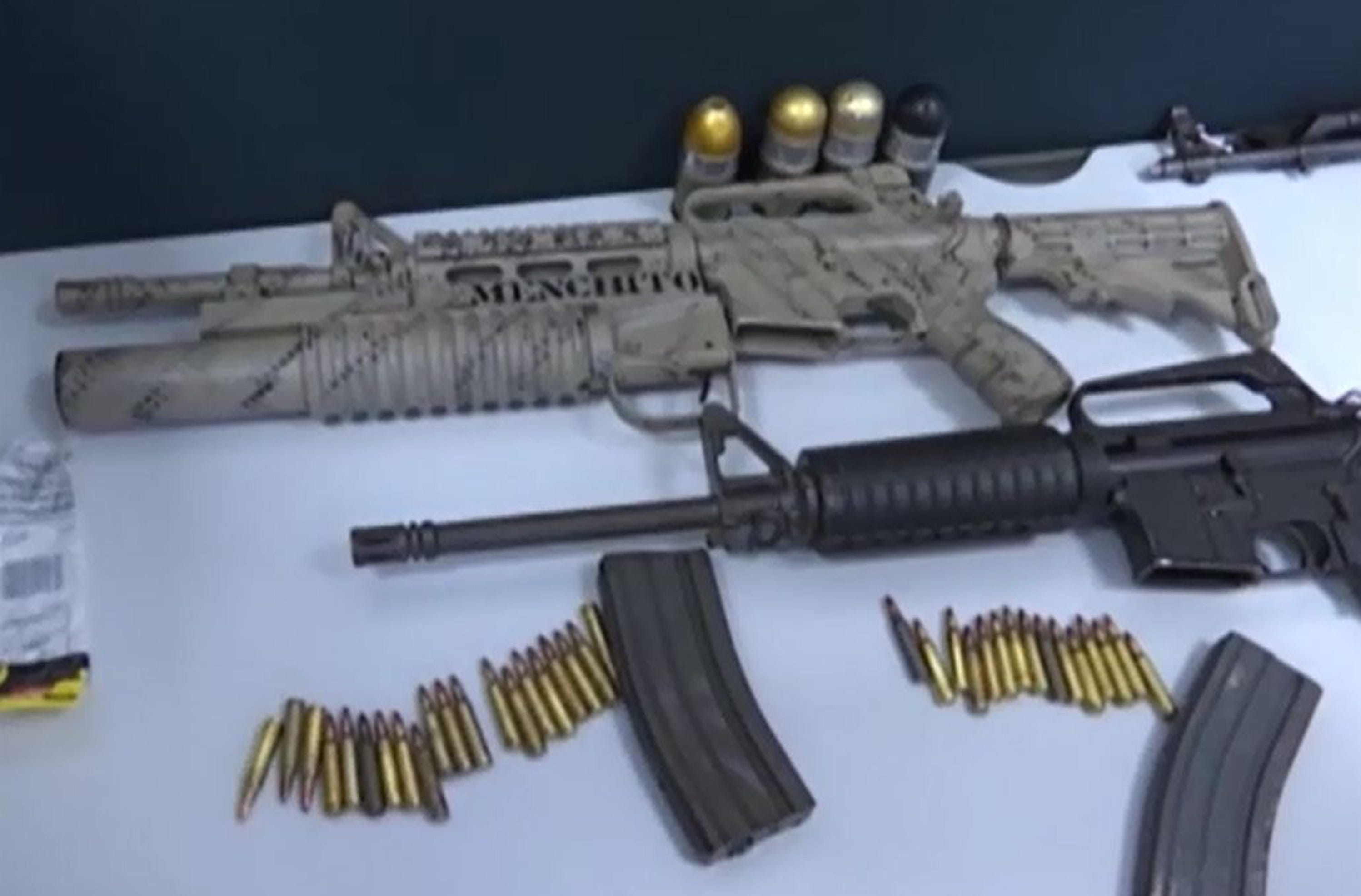 """El Mencho's son, Rubén Oseguera González, was No. 2 in command of the billion-dollar cartel. During his arrest, police found these assault rifles. One is inscribed """"CJNG 02 JR,"""" and the other  displays """"Menchito,"""" which means little Mencho."""