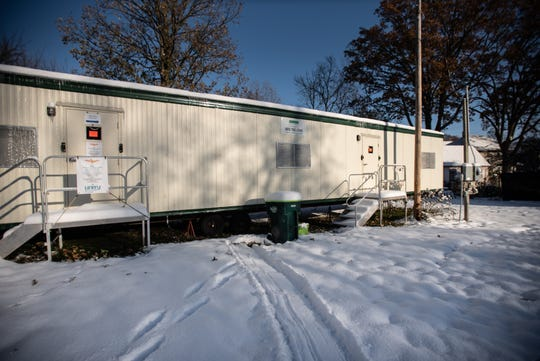 The trailer behind Unity Spiritual Center of Lansing that was a makeshift office for staff until it was recently red tagged.
