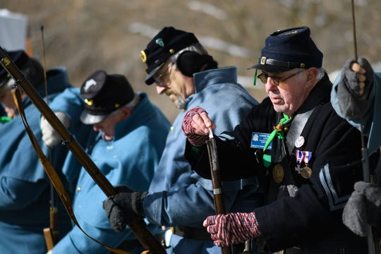 Howard Lloyd, right, of Jackson, and fellow members of the Sons of Union Veterans of the Civil War reload during a military salute honoring the late John Taylor, Tuesday, Nov. 12, 2019 in Delhi Township.  Formerly known as Deadman's Hill, the park was dedicated John Taylor Memorial Park.