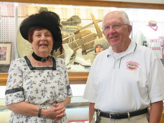Jan Augenstein depicting Florence Harding and Phil Reid, local historian, discuss the everyday life exhibit at the Marion County Historical Society.
