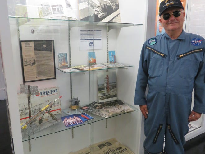 Bill Bradford portraying John Glenn in front of the exhibits about the Marion Power Shovel and The Space Race To The Moon at the Marion County Historical Society.