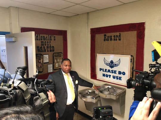 Shelby County Schools Superintendent Joris Ray shows a decommissioned drinking fountain found to have high levels of lead in its water at Idlewild Elementary. Water sources like this fountain have been turned off and are no longer able to be used by students.
