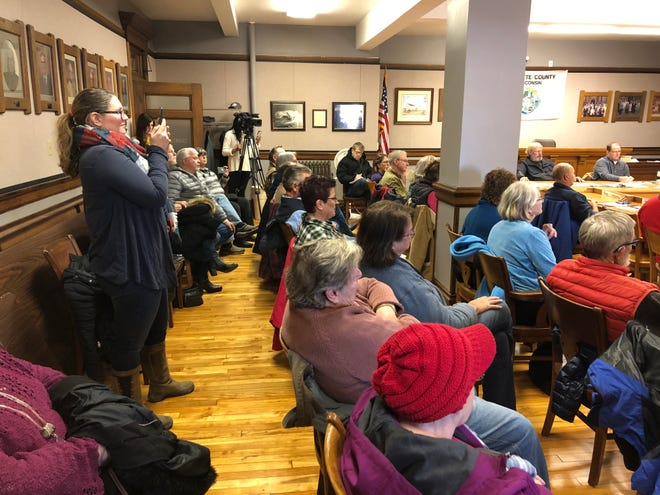 Members of the public attend a meeting at which Lafayette County officials advanced a resolution to sanction county officials who speak about water quality studies without authorization.