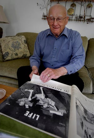 In this 2009 photo, Joe Demler, from his home in Port Washington,  recounts his life as a prisoner of war at Stalag XIIA in Germany. He weighed about 70 pounds after his three-month ordeal and was featured in Life magazine in 1945.