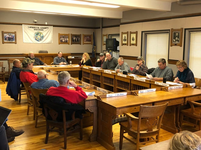 Members of a Lafayette County committee discuss a resolution to discipline county officials who speak about water quality studies without permission, during a meeting Tuesday.