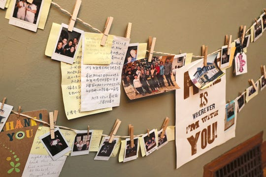 Airbnb guests have left photos and messages on the dining room wall of Deborah Heffner's home, which she has rented on Airbnb for the last three years.