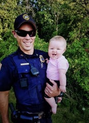 Sergeant Lucas Twelmeyer, pictured with daughter Bonnie, organized a diaper drive to benefit the Waukesha County Food Pantry.