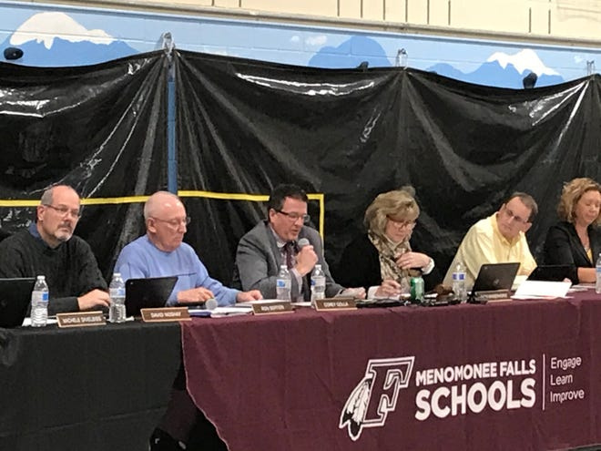 Menomonee Falls School District superintendent Corey Golla (middle, with microphone) gives his recommendation on the Menomonee Falls mascot at the board's Nov. 11 meeting.