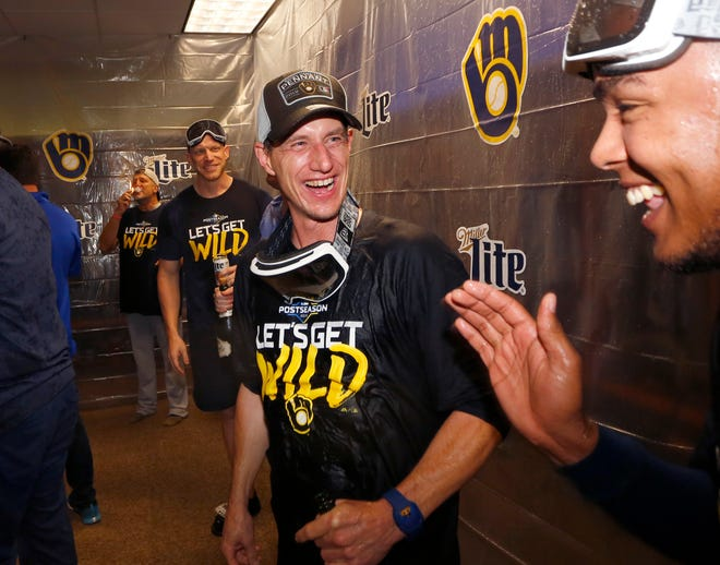 Sep 25, 2019; Cincinnati, OH, USA; Milwaukee Brewers manager Craig Counsell celebrates in the clubhouse after clinching a playoff berth defeating the Cincinnati Reds at Great American Ball Park. Mandatory Credit: David Kohl-USA TODAY Sports