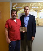 Baxter Regional Medical Center Home Health employee Mike Severa (left) was one of four area veterans to be recognized for their service by Baxter Regional Medical Center President/CEO Ron Peterson (right) on Monday.