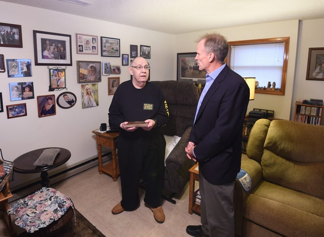 Air Force veteran Thomas Lawson (left) and Baxter Regional Medical Center President/CEO Ron Peterson (right) chat during a Home Health visit at Lawson's house on Monday morning.