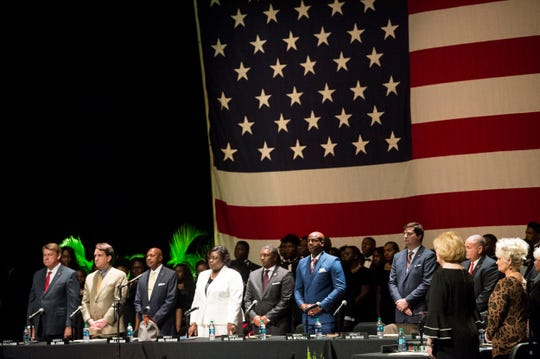 City Council members stand for the national anthem during Inauguration at the Montgomery Performing Arts Center in Montgomery, Ala., on Tuesday, Nov. 12, 2019.