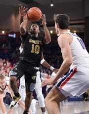 Nov 5, 2019; Spokane, WA, USA; Alabama State Hornets guard Jacoby Ross (10) shoots the basketball against Gonzaga Bulldogs forward Pavel Zakharov (10) in the second half at McCarthey Athletic Center. The Bulldogs won 95-64. Mandatory Credit: James Snook-USA TODAY Sports