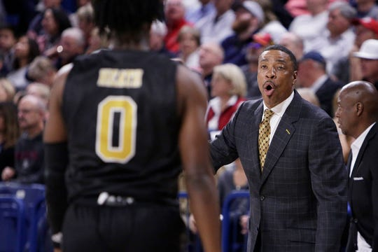 Alabama State head coach Lewis Jackson, right, speaks with guard DJ Heath during the first half of an NCAA college basketball game against Gonzaga in Spokane, Wash., Tuesday, Nov. 5, 2019. (AP Photo/Young Kwak)