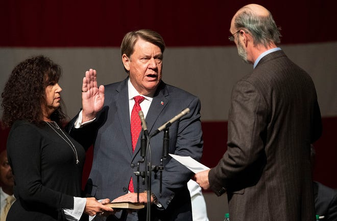 District 1 City Councilor Richard Bollinger is sworn in by Gene Reese during the Mayor's Inauguration and city council organizational meeting at the Montgomery Performing Arts Center in Montgomery, Ala., on Tuesday November 12, 2019.
