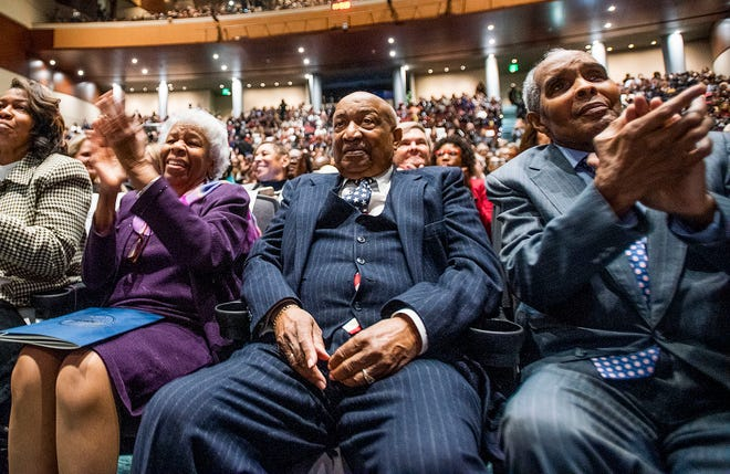 Molly Reed, Joe Reed and Jerome Gray clap following the inauguration of Montgomery Mayor Steven Reed at the Montgomery Performing Arts Center in Montgomery, Ala., on Tuesday November 12, 2019.