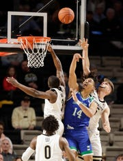 Texas A&M-Corpus Christi forward Elijah Schmidt (14) fights for a rebound with Vanderbilt's Maxwell Evans (3) and Oton Jankovic, right, in the first half on Monday, Nov. 11, 2019, in Nashville, Tenn.