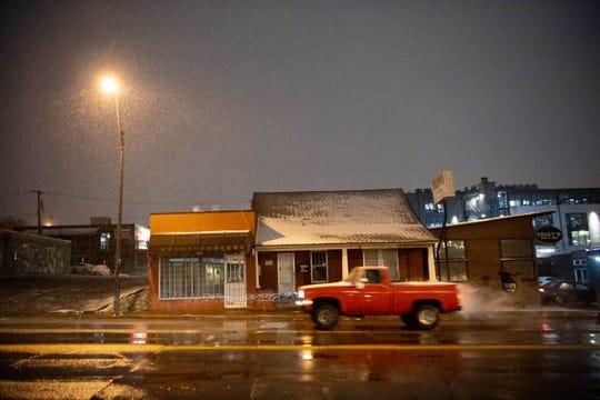 Snow falls in East Nashville early Tuesday, Nov. 12, 2019 in Nashville, Tenn.