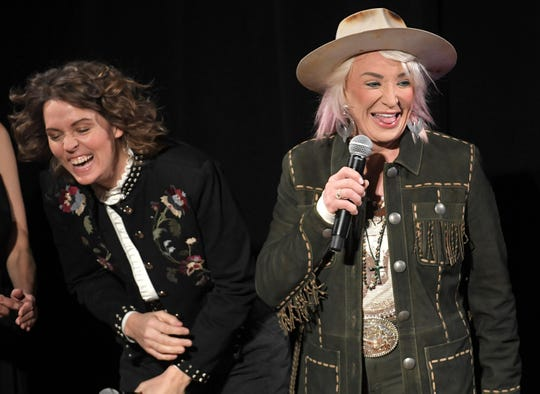 Tonya Tucker, right, jokes on stage with Brandi Carlile at the seventh annual Next Women of Country celebration at the CMA Theater at the Country Music Hall of Fame and Museum in Nashville on Tuesday, Nov. 12, 2019.