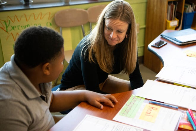Joy Van Est works with a student Tuesday, Nov. 12, 2019, at Robert Churchwell Museum Magnet in Nashville. In high-poverty schools like Robert Churchwell, teachersare increasingly called on to serve asfirst responders when it comes to children'sbasic needs.