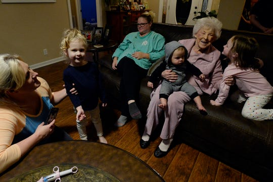 Cottontown matriarch Junita Edwards, known as Mama Greene, sits with some of her grandchildren and great-great-grandchildren on Monday, October 28, 2019, in White House, Tenn. Edwards, 92, has 22 great-great-grandchildren.