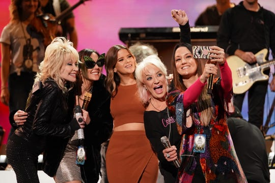 "Carrie Underwood, Crystal Gayle, Dolly Parton, Gretchen Wilson, The Highwomen, Jennifer Nettles, Loretta Lynn, Martina McBride, Reba McEntire, Sara Evans, Tanya Tucker, Terri Clark, rehearse for ""The 53rdAnnual CMA Awards"" live on Wednesday, November 13, 2019 at Bridgestone Arena in Downtown Nashville.  Pictured, Parton along with Amanda Shires, Maron Morris, Tucker and Natalie Hemby pose for a selfie during rehearsal."