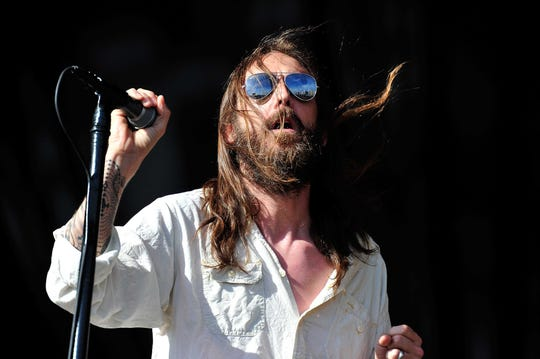 Chris Robinson of the Black Crowes performs at Hard Rock Calling in London, England in 2013. The Black Crowes, featuring his brother Rich, broke up in 2015, but a logo that's popped up on the band's site and Facebook page has recently started appearing on digital billboards in Milwaukee.