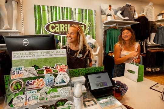 Cariloha Bamboo sales interns, Tayler Hall, left, and Madison Atkins help customers at the register,  Tuesday, Nov. 12, 2019, at their shop located at in the Mercato in North Naples.