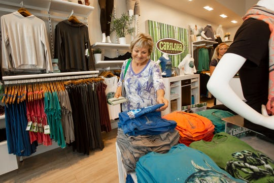 Customer Barb Lafleche of Toronto, Canada, shops, Tuesday, Nov. 12, 2019, at Cariloha Bamboo at located in Mercato shopping center in North Naples.