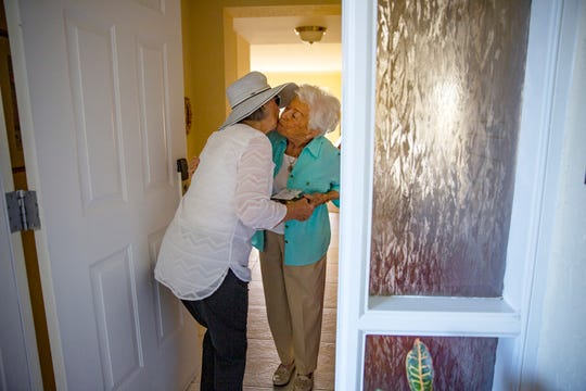 Ramona Barrett greets her friend Carolyn Brown, Tuesday, Nov. 12, 2019, at her home in North Naples.