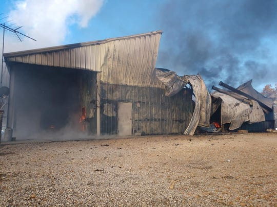 Multiple departments, including Madison Township Fire Department, responded to a barn fire in Fallsbury Township on Tuesday, Nov. 12, 2019.