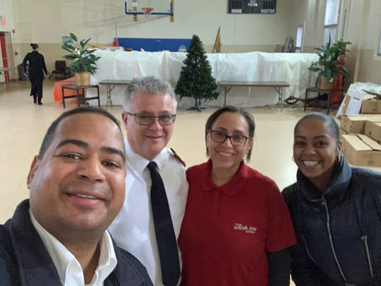 Mayor Hector Lora with Salvation Army majors Miguel and America Barriera and Lora's Assistant Kathy Martin shortly after they came to an agreement on Tuesday to use the Salvation Army site on Main Avenue as emergency shelter.