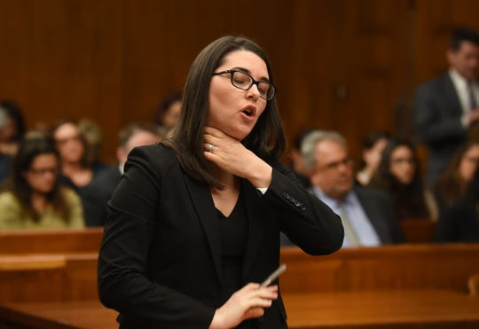 Suzanne Cevasco, assistant prosecutor, demonstrates how the victim was choked by Michael Gaffney, 21, of Maywood, who is accused of choking a 19-year-old woman while having sex in her car, during a detention hearing before Judge Margaret Foti at Bergen County Courthouse in Hackensack on Nov. 12, 2019. He's charged with manslaughter.