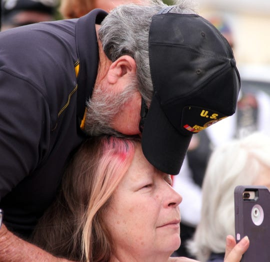 Edward and Gwen Miller are overcome with emotion listening to their daughter and son-in-law give the keynote speech during Monday's Veterans Day ceremony at Veterans Park.