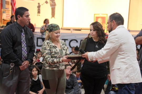 Members of the Henry Morales family received special honors during a school assembly dedicated in his name. Morales was a Vietnam veteran.
