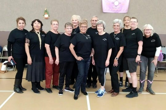 Members of the Zia Zingers are, pictured from left, Concha, Iris, Ruth, Peggy, Phyllis, Vickie, Mike, Pat, Carol, Liv, Joyce & Sherrie