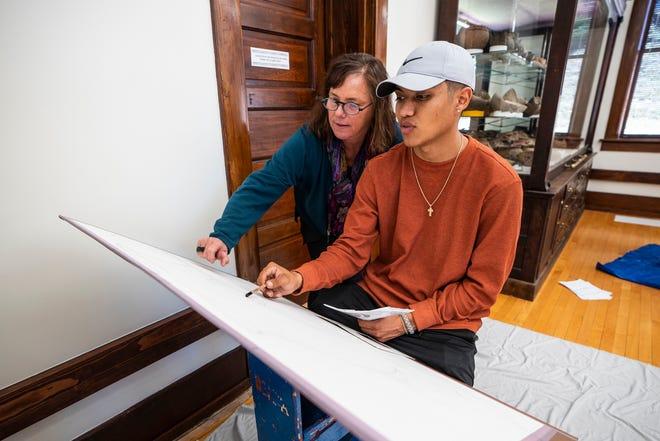 Western New Mexico UniversityDrawing I instructor Jennifer Douglass teachesgraphic design student Christian Gonzalez.