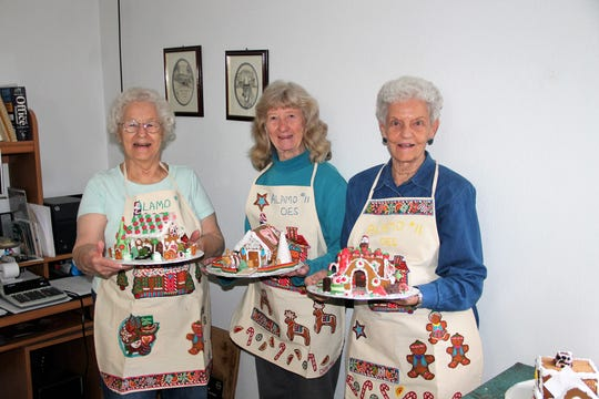Dana Ridge, Rae Keeney and Mildred Toon show off some of the gingerbread houses they have made this year.  They are with the Order of the Eastern Star #11 and since 1978 they have made gingerbread houses that they sell as a fundraiser for charities and scholarships.
