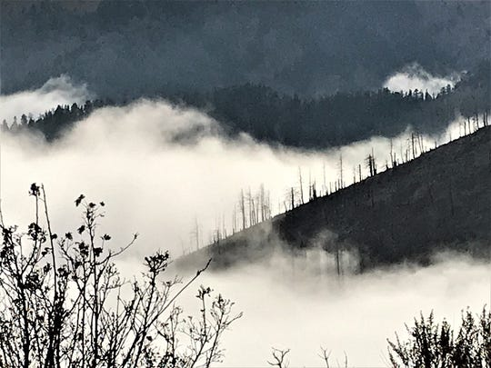 Frigid air moves into the valleys between mountains near Ruidoso, creating heavy fog and a scene worthy of any spooky movie.