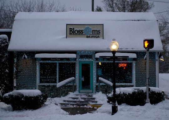 Milford's Blossoms on Main already has its holiday lights up on display.