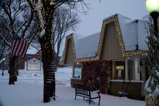 Czapski's on Main Street in Milford has a number of trees and their front windows lit up this year.