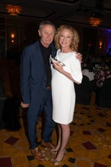 Honoree Virginia Madsen shows off her award with her presenter, Tristan Rogers.