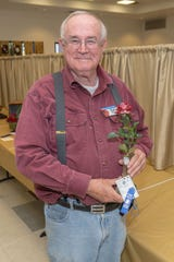 "Bob Martin Jr. from Escondido has 560 rose bushes and, among other awards, won a first with his miniflora called ""Strawberry Kisses."""